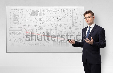 Handsome businessman holding modern laptop Stock photo © ra2studio