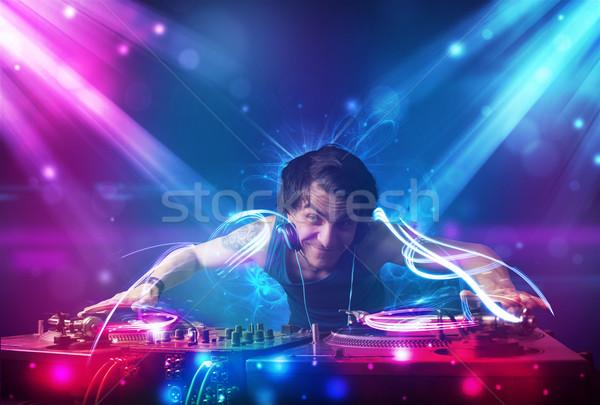 Energetic Dj mixing music with powerful light effects Stock photo © ra2studio
