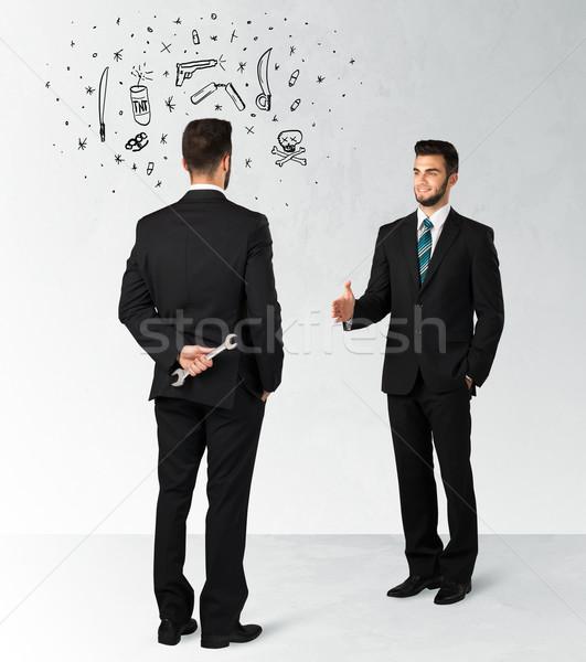 Działalności biznesmen handshake ukrywanie broń symbolika Zdjęcia stock © ra2studio