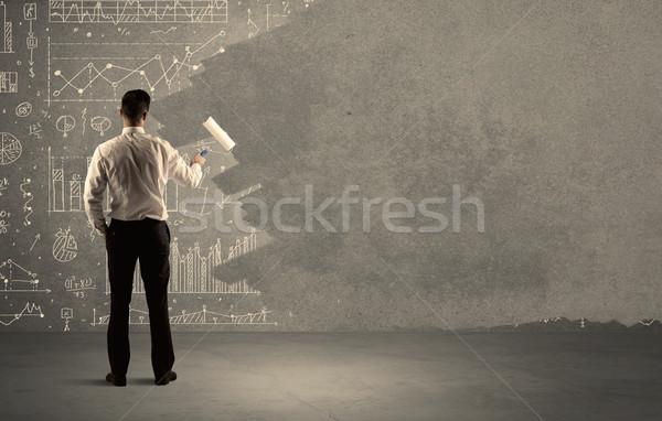 Venditore pittura classifiche muro elegante imprenditore Foto d'archivio © ra2studio