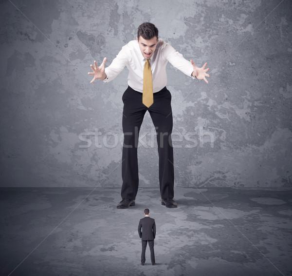 Big boss looking at tiny coworker Stock photo © ra2studio