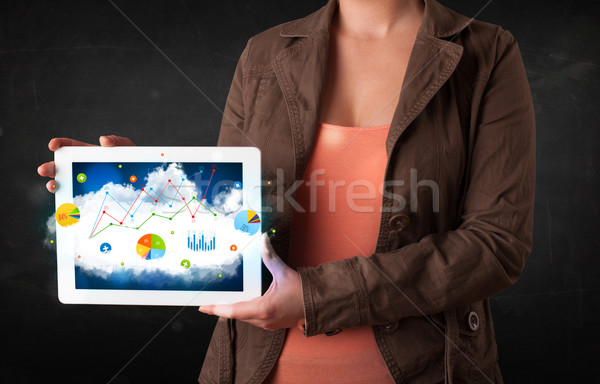 Person holding a touchpad with cloud technology and charts Stock photo © ra2studio