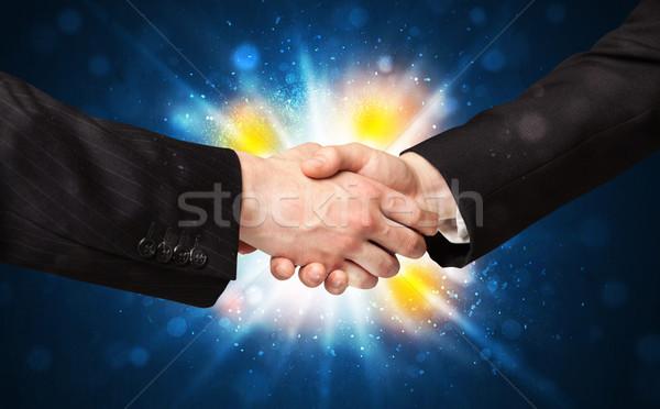 Dos hombres de negocios apretón de manos acuerdo explosión negocios Foto stock © ra2studio