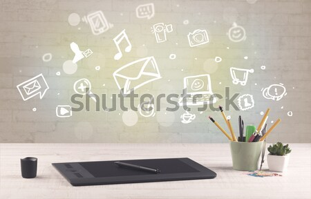 Office desk with communication icons Stock photo © ra2studio
