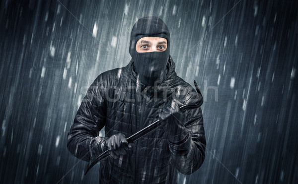 Stock photo: Caught burglar by house camera in action.