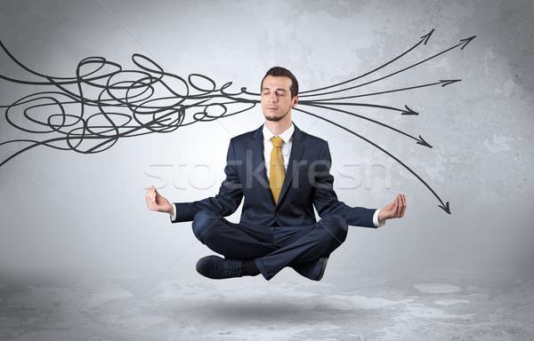 Businessman meditates with purifying doodle concept Stock photo © ra2studio