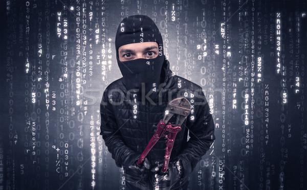 Burglar in action with encoded concept. Stock photo © ra2studio