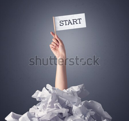 Female hand holding start sign Stock photo © ra2studio