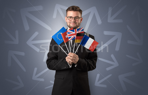 Stock photo: Cheerful boy standing with flag and arrows around