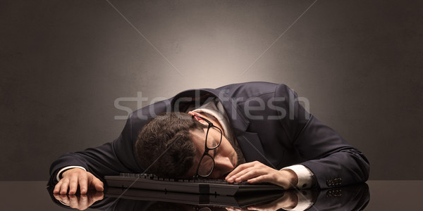 Businessman fell asleep at his workplace Stock photo © ra2studio