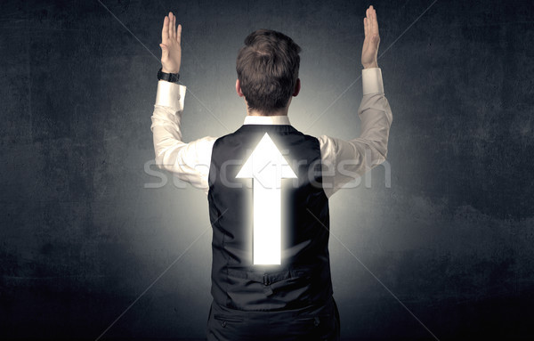 Young businessman standing with arrow on his back Stock photo © ra2studio