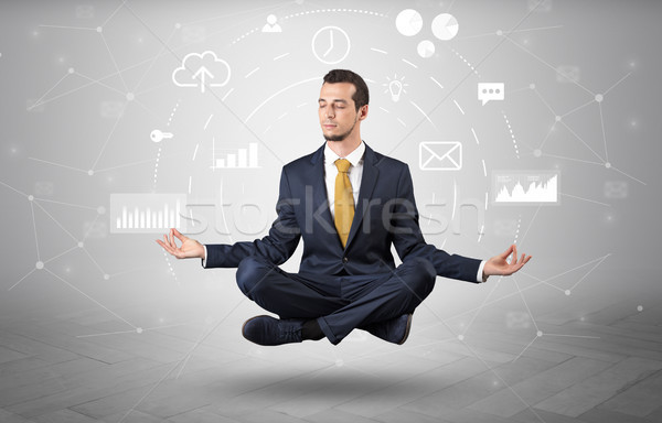Businessman levitates with data circulation concept Stock photo © ra2studio
