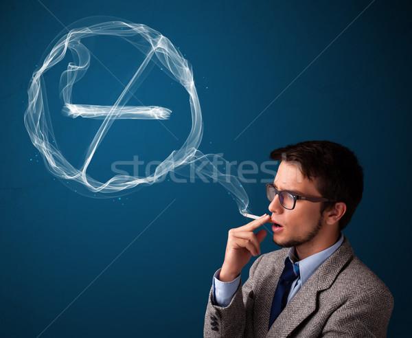 Jonge man roken ongezond sigaret teken Stockfoto © ra2studio