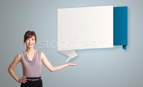 woman presenting modern origami copy space Stock photo © ra2studio