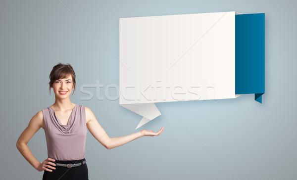 Nő bemutat modern origami copy space vonzó Stock fotó © ra2studio
