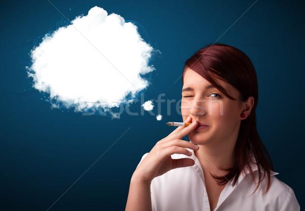 Young woman smoking unhealthy cigarette with dense smoke Stock photo © ra2studio