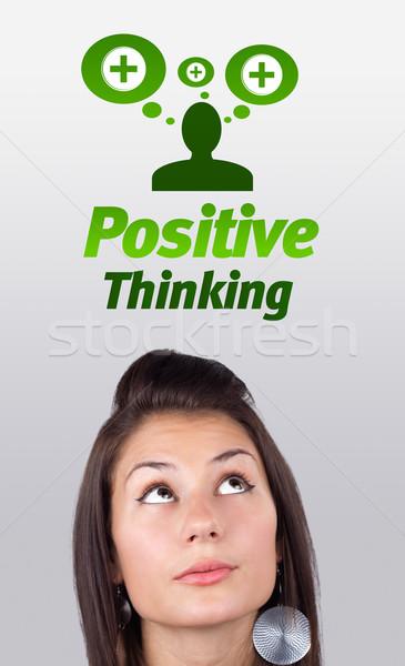 若い女の子 見える ポジティブ 負 標識 頭 ストックフォト © ra2studio