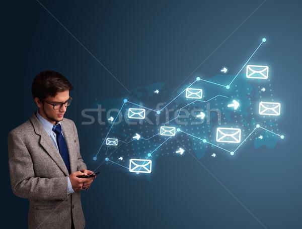 Fiatalember tart telefon nyilak üzenet ikonok Stock fotó © ra2studio