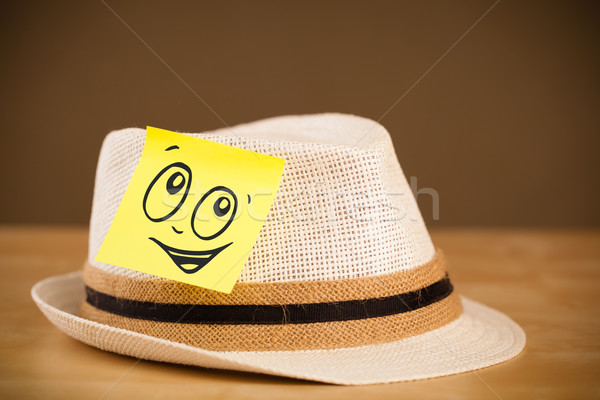 Post-it note with smiley face sticked on hat Stock photo © ra2studio