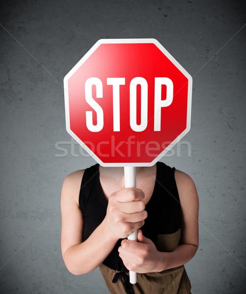 Fiatal nő tart stoptábla fiatal hölgy áll Stock fotó © ra2studio