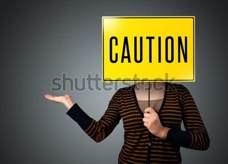 Fiatal nő tart vigyázat felirat fiatal hölgy Stock fotó © ra2studio