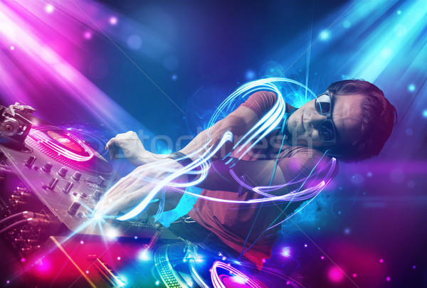 Energetic Dj mixing music with powerful light effects Stock photo © ra2studio