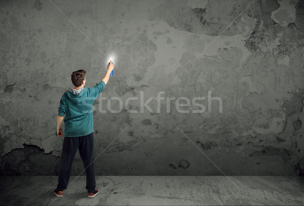 Young urban painter starting to draw Stock photo © ra2studio