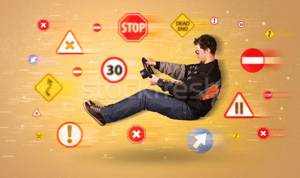 Jonge bestuurder verkeersborden rond auto weg Stockfoto © ra2studio