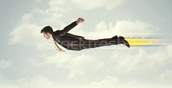 Boldog üzletember repülés gyors égbolt felhők Stock fotó © ra2studio