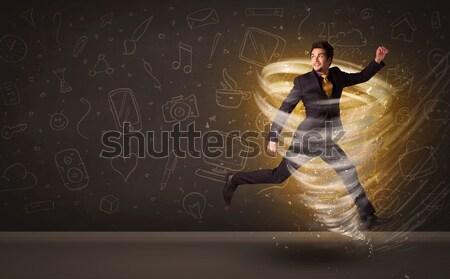 Feliz empresário saltando tornado marrom negócio Foto stock © ra2studio