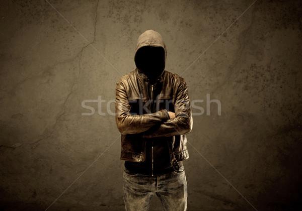 Stock photo: Undercover hooded stranger in the dark
