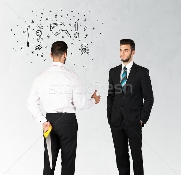 бизнеса бизнесмен рукопожатие сокрытие оружием Сток-фото © ra2studio
