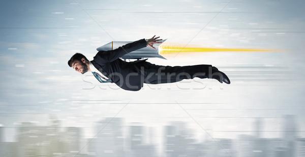 Superhero człowiek biznesu pływające jet opakowanie rakietowe Zdjęcia stock © ra2studio