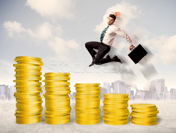 成功した ビジネスマン ジャンプ アップ 金貨 お金 ストックフォト © ra2studio