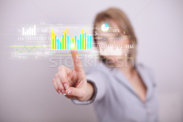 Young business woman touching colorful charts and diagrams Stock photo © ra2studio