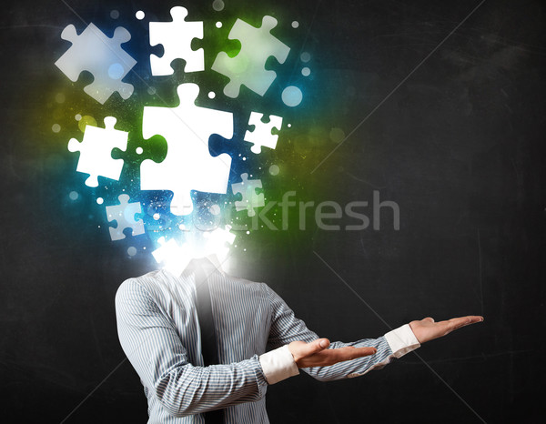 Character in suit with puzzle head concept Stock photo © ra2studio