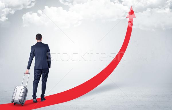 Businessman leaving on the red carpet arrow Stock photo © ra2studio
