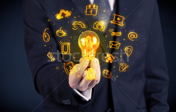 salesman promoting his bright ideas Stock photo © ra2studio