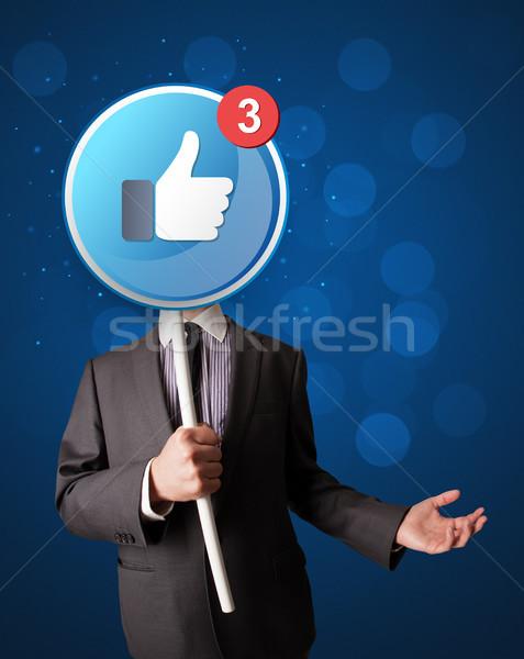 üzletember tart facebook felirat okos ahogy Stock fotó © ra2studio