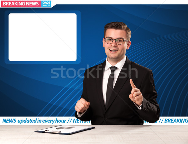 Television reporter telling breaking news at his studio desk with copy space  Stock photo © ra2studio