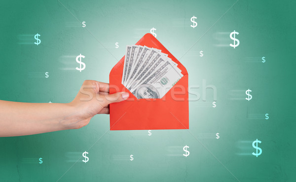 Hand holding envelope with symbols around Stock photo © ra2studio