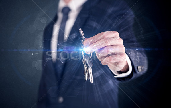 Man holding keys with connection concept Stock photo © ra2studio