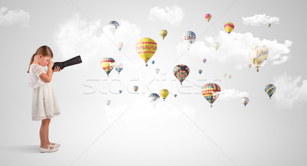 Kid looking through spyglass to air balloons Stock photo © ra2studio