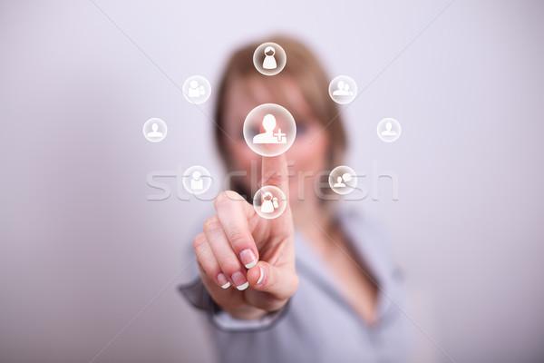 Woman pressing social media add friend button Stock photo © ra2studio