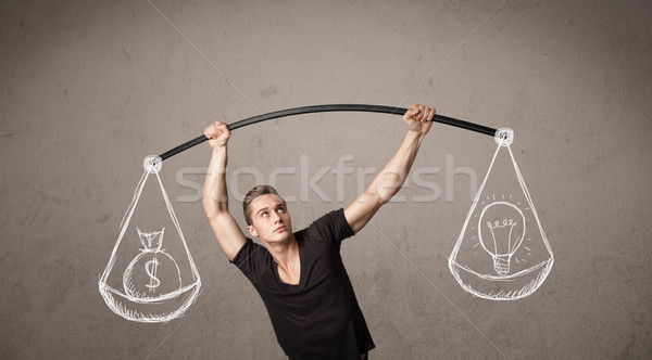 muscular man trying to get balanced  Stock photo © ra2studio