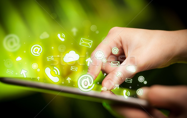 Hand touching tablet pc, social media concept Stock photo © ra2studio