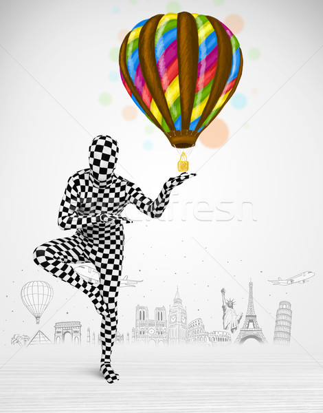 man in full body suit holding balloon Stock photo © ra2studio