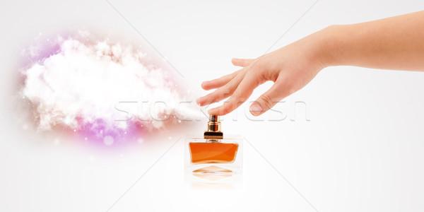 woman hands spraying colorful cloud Stock photo © ra2studio