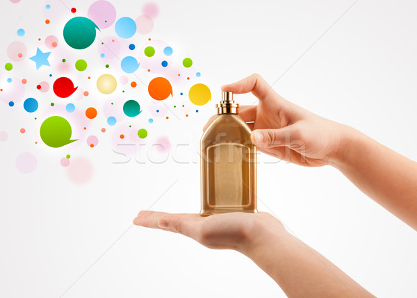close up of woman hands spraying colorful bubbles from beautiful perfume bottle Stock photo © ra2studio