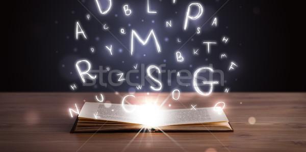 Açık kitap harfler uçan dışarı ahşap Stok fotoğraf © ra2studio